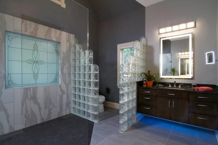 Bathroom vanity with floor lighting Alcorn's Custom Woodworking